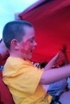 Deeds LOVED getting under the huge flag as it came by at the soccer game.