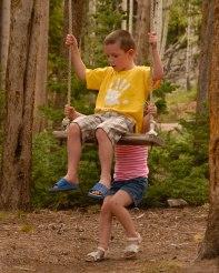 Gwen pushing Deeds on the swing.