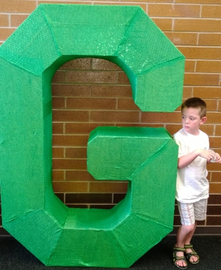 Deeds standing by the big G at his Elementary school.